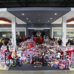 Team members with Kia Motors Manufacturing Georgia have plant's biggest ever 'Toys for Tots' drive